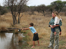 Christiaan showing off his fishing skills to Leesa