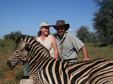 Pieter with Leesa and one of the several Zebra they've taken together
